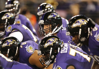Ravens' Flacco lines his team up for a play against the Falcons during the first half of their NFL pre-season football game in Baltimore