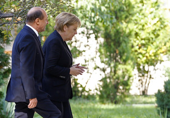 Romania's President Basescu and German Chancellor Merkel visit the Cotroceni presidential palace in Bucharest