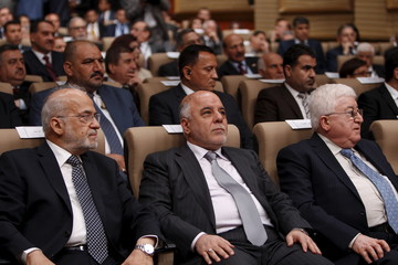 Iraq's Prime Minister Abadi, Foreign Minister Jaafari and President Massoum attend a conference at the Foreign Ministry in Baghdad