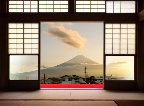 Traditional Japanese indoor  house and paper sliding doors and tatami mat open to View of a beautiful sunset Fuji mountain and japanese house in autumn season. Kawaguchiko, Yamanashi, Japan