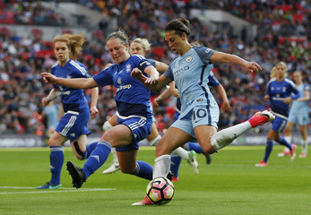 Manchester City's Carli Lloyd in action with Birmingham City's Kerys Harrop