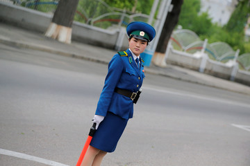 A policewoman controls traffic in central Pyongyang
