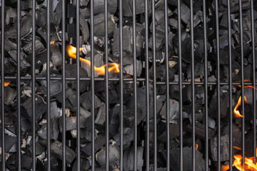 Grill, BBQ, fire, charcoal barbecue, closeup. Roaster grate for cooking