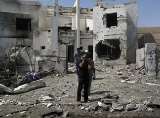 The cameraman of al-Arabiya satellite channel films the site of a bomb attack in Baghdad