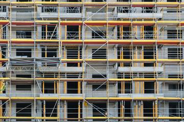 scaffolding on facade,  building under construction