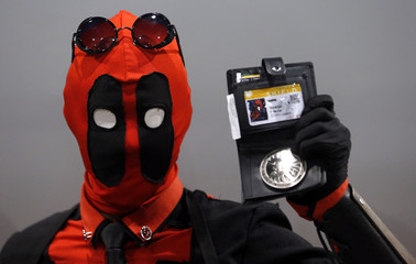 A participant dressed in a superhero costume poses for a picture during the first edition of HeroFestival in Marseille