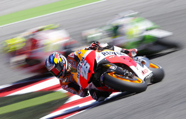 Honda MotoGP rider Pedrosa of Spain takes a curve during the qualifying session of the San Marino Grand Prix in Misano circuit in central Italy