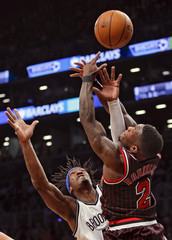 Brooklyn Nets Gerald Wallace blocks shot by Chicago Bulls Nate Robinson in NBA game in New York