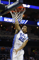 Duke Blue Devils guard Andre Dawkins dunks the ball against the Hampton Pirates during their second round NCAA men's basketball game in Charlotte