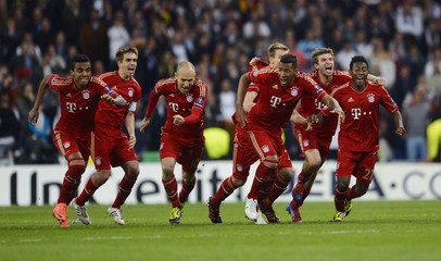 Bayern Munich's players celebrate victory against Real Madrid after their Champions League semi-final second leg soccer match at Santiago Bernabeu stadium in Madrid