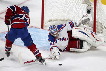 New York Rangers Biron stops a shot by Montreal Canadiens Gallagher during their NHL hockey action in Montreal