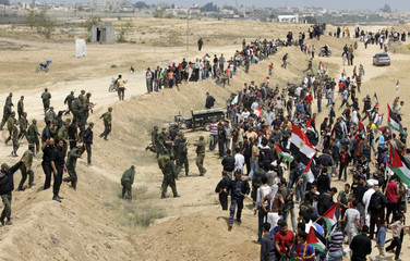 """Palestinians attend a protest to mark """"Nakba"""" near the border between Egypt and southern Gaza Strip"""