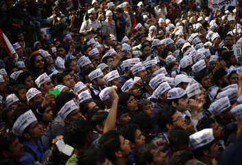 Supporters of AAP take part in the celebrations outside the AAP office in New Delhi