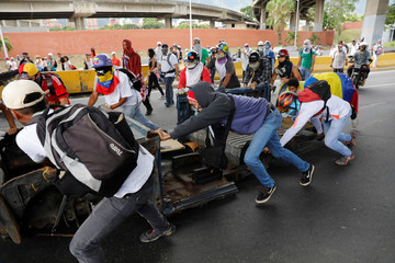 Demonstrators build barricades during a protest against Venezuela's President Nicolas Maduro's government in Caracas, Venezuela