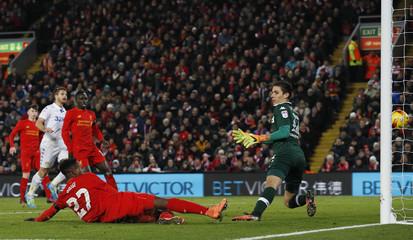 Liverpool's Divock Origi scores their first goal