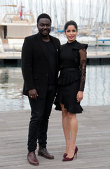 "Cast members Babou Ceesay and Freida Pinto pose during a photocall for the television series ""Guerrilla"" during the annual MIPCOM television programme market in Cannes"