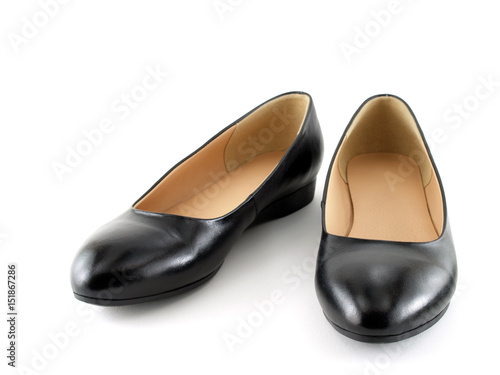 53ba12092 close up pair of black women shoes (low-heeled) isolated on white background,  flat shoes simple and formal style for women