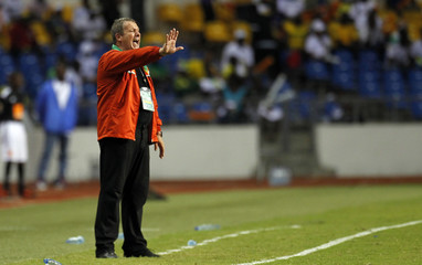 Niger's coach Roland Corbis talks to his players during their African Cup of Nations soccer match against Tunisia in Libreville