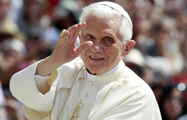 Pope Benedict XVI waves as he arrives to lead his weekly general audience at St. Peter's Square in the Vatican