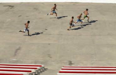 Teenagers workout at the beach on a hot summer day in Oceanside, California
