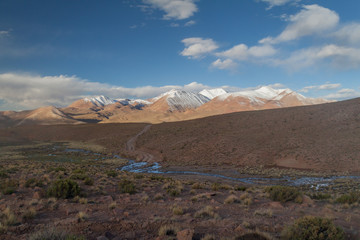 Snow covered mountains soaring from altiplano in Bolivia