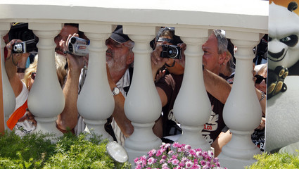"""Fans try to take pictures as voice actress Jolie poses during a photocall for the animated film """"Kung Fu Panda 2"""" during the Cannes Film Festival"""
