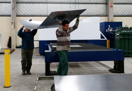 Labourers work at the Gottert machinery and tools plant factory in Garin, Argentina