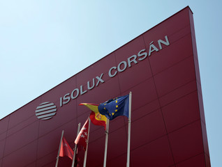 Flags wave next to the logo of Spanish construction company Isolux Corsan at their headquarters in Madrid, Spain