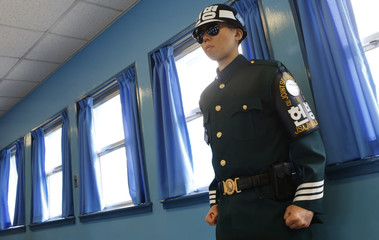 A South Korean soldier stands guard in the UN Command Military Armistice Commission Conference Building at the truce village of Panmunjom in the DMZ in Paju