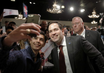U.S. Republican presidential candidate Marco Rubio poses for a selfie with a supporter following a campaign event at the Silverton Casino in Las Vegas