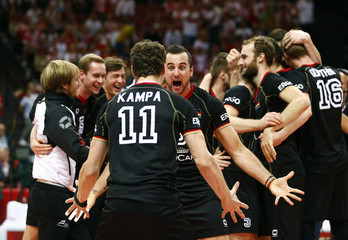 Germany's players celebrate defeating France to win third place match in Volleyball Men's World Championship in Katowice