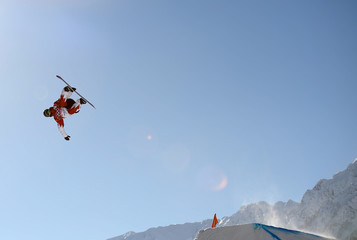Snowboarder Sebastien Toutant of Canada performs a jump during slopestyle snowboard training at the 2014 Sochi Winter Olympics in Rosa Khutor