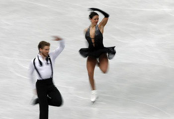 Aldridge and Eaton of the U.S. compete during the ice dance short dance program at the ISU World Figure Skating Championships in Saitama