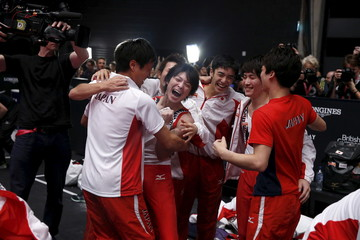 Japan celebrate winning gold in the men's team final at the World Gymnastics Championships at the Hydro arena in Glasgow