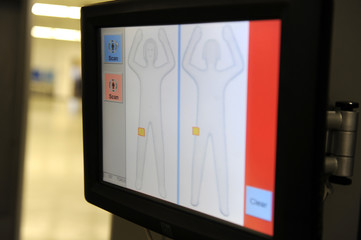 Image of a passenger appears on the screen as Transportation Security Administration employees demonstrate new body scanner software in Arlington, Virginia
