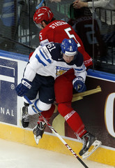 Finland's Huhtala collides with Stasenko of Belarus during the first period of their men's ice hockey World Championship Group B game at Minsk Arena in Minsk