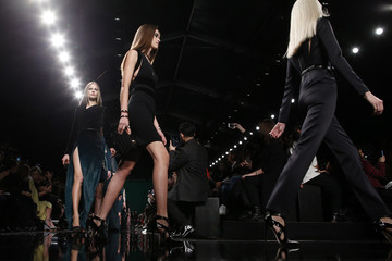 Models present creations by Lebanese designer Elie Saab as part of his Fall/Winter 2014-2015 women's ready-to-wear collection show during Paris Fashion Week