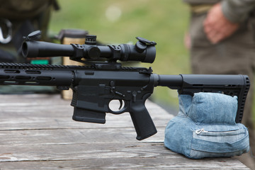 Sniper rifle. Horizontally. On the table in the forest.