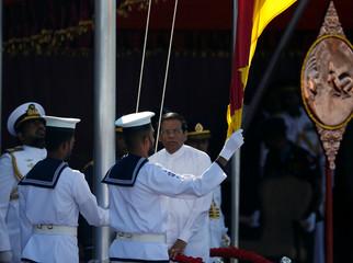 Sri Lanka's president Maithripala Sirisena raises the national flag during Sri Lanka's 69th Independence day celebrations in Colombo