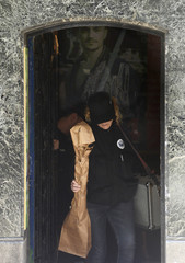 Police remove evidence from the Zen4 gymnasium after arresting the owner who is a kung fu martial arts expert on suspicion of murder in Bilbao