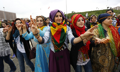Supporters of the Pro-Kurdish Peoples' Democratic Party (HDP) dance during a gathering to celebrate their party's victory during the parliamentary election, in Istanbul