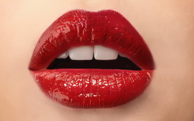 Woman with red lips close up