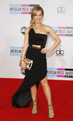 Actress Julie Benz arrives at the 2010 American Music Awards in Los Angeles
