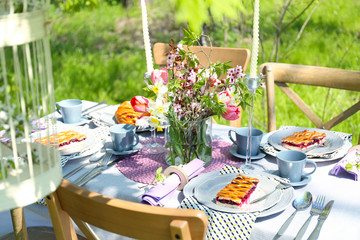 Table setting with flowers in garden