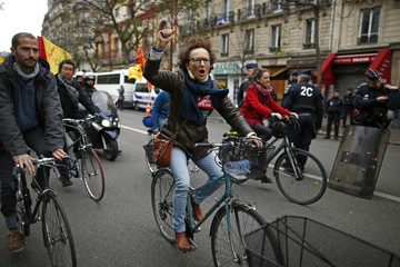 People ride bicycles as they demonstrate to show solidarity for climate change after the cancellation of a planned climate march ahead of the World Climate Change Conference 2015 in Paris