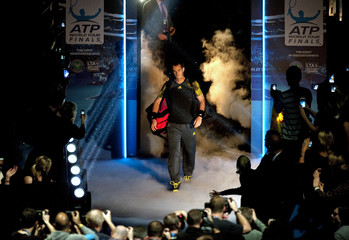 Murray of Britain walks onto court to play Berdych of Czech Republic in their men's singles tennis match at the ATP World Tour Finals in London