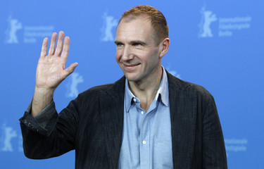 Actor and director Fiennes waves as he poses during a photocall to promote the movie 'Coriolanus' at the 61st Berlinale International Film Festival in Berlin