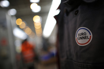 A company logo is seen on a Eurotunnel worker's vest at the Channel tunnel in Coquelles