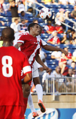 Belize's Eiley goes up for a header against Cuba's Molina during their CONCACAF Gold Cup soccer match in Hartford