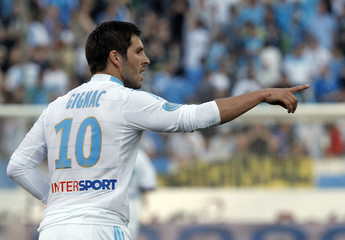 Olympique Marseille's Gignac celebrates after scoring against Toulouse during his French Ligue 1 soccer match at the Velodrome stadium in Marseille
